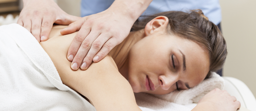 A New York Massage Institute student gives a massage. If you want to take a great Massage Therapy program in Williamsville, NY come to NYIM.