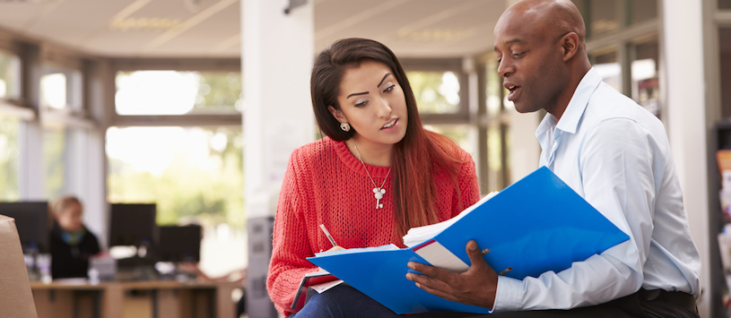 A NYIM financial aid advisor counsels a student. Figure out how to fund your Massage Therapy training in Williamsville, NY.